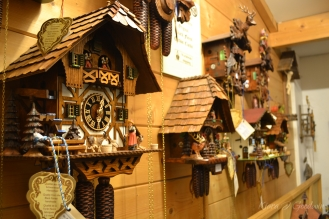 The woodcarving shop full of intricate clocks...